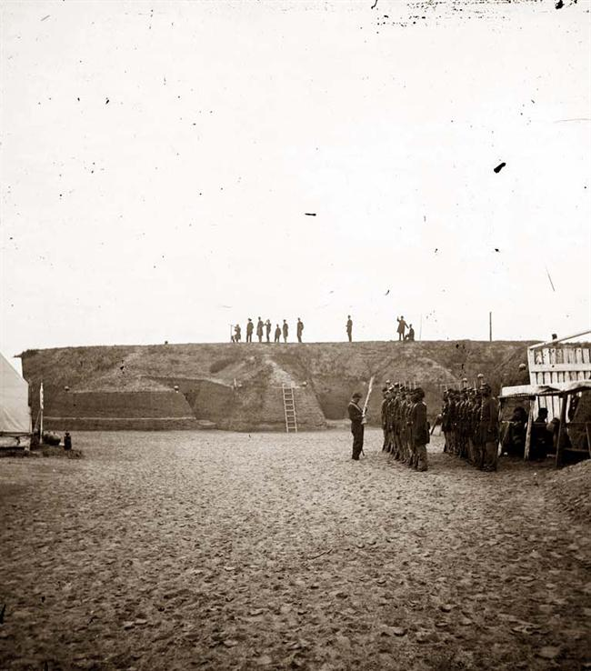 Photograph of the 54th regiment mounting guard in the occupied Fort Wagner